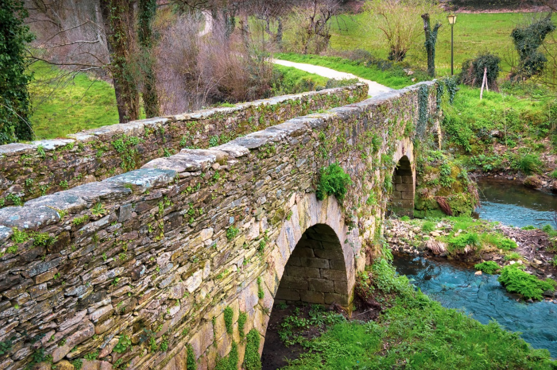 The Medieval Bridge Puente outside the Town of Sarria in Galicia